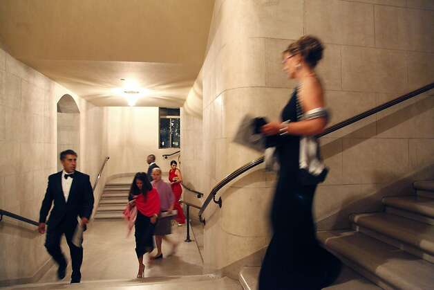 Opera patrons make their way to their seats for the opening performance of the San Francisco Opera's 90th Season on Friday, Sept. 7, 2012. Those in attendance were entertained with Giuseppe Verdi's Rigoletto conducted by Music Director Nicola Luisotti. Photo: Alex Washburn