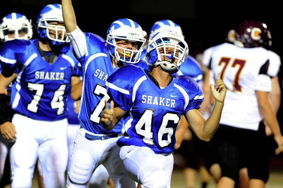 Shaker's Devin Durner (46), center, celebrates his touchdown during their football game against Colonie on Friday, Sept. 7, 2012, at Shaker High in Latham, N.Y. (Cindy Schultz / Times Union) Photo: Cindy Schultz / 00019129A