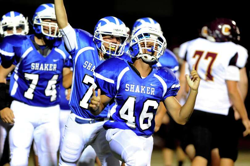 Shaker's Devin Durner (46), center, celebrates his touchdown during their football game against Colo