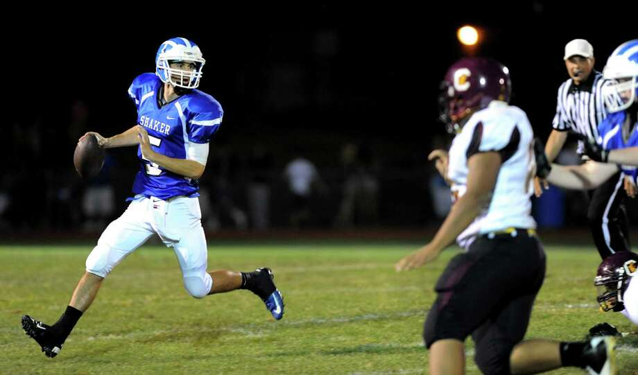 Shaker's quarterback Chris Landers (5), left, looks to pass during their football game against Colonie on Friday, Sept. 7, 2012, at Shaker High in Latham, N.Y. (Cindy Schultz / Times Union) Photo: Cindy Schultz / 00019129A