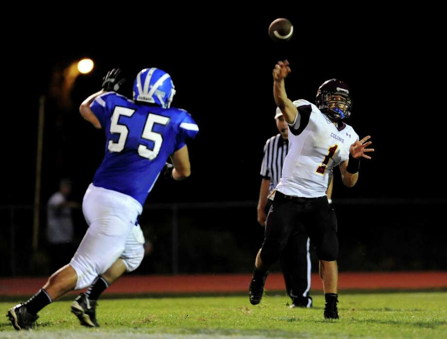Colonie's quarterback Devon Edwards (1), right, passes the ball during their football game against Colonie on Friday, Sept. 7, 2012, at Shaker High in Latham, N.Y. (Cindy Schultz / Times Union) Photo: Cindy Schultz / 00019129A
