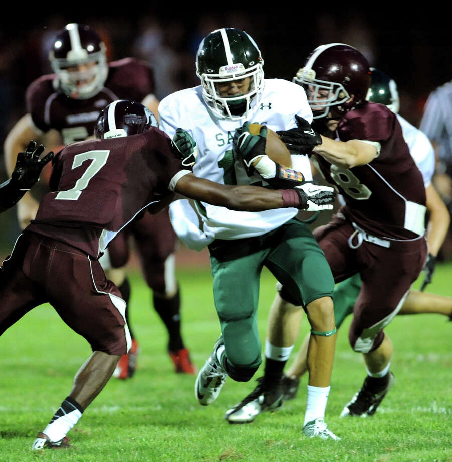Schalmont's Chas Higgins (15), center, runs into tough defense l during their football game against Burnt Hills on Friday, Sept. 7, 2012, at Burnt Hills High in Burnt Hills, N.Y. (Cindy Schultz / Times Union) Photo: Cindy Schultz / 00019129A