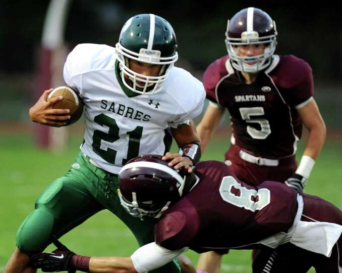 Schalmont's quarterback Devon Willis (21), right, runs runs the ball during their football game agai