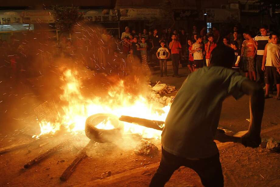 Palestinian youth burn tyres during a protest against the high cost of living at the Dheisheh refugee camp near the West Bank city of Bethlehem on September 7, 2012. Photo: Musa Al-shaer, AFP/Getty Images