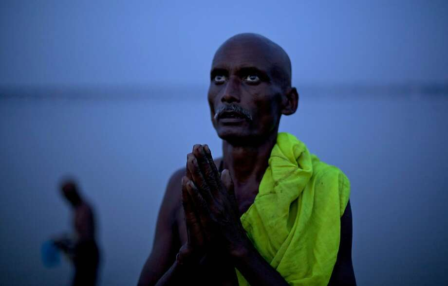 A Hindu devotee performs evening rituals on the banks of the River Ganges in Allahabad, India, Friday, Sept. 7, 2012.  Allahabad, at the confluence of the rivers Ganges, Yamuna and the mythical Saraswati, is an important Hindu pilgrimage center. Photo: Rajesh Kumar Singh, Associated Press