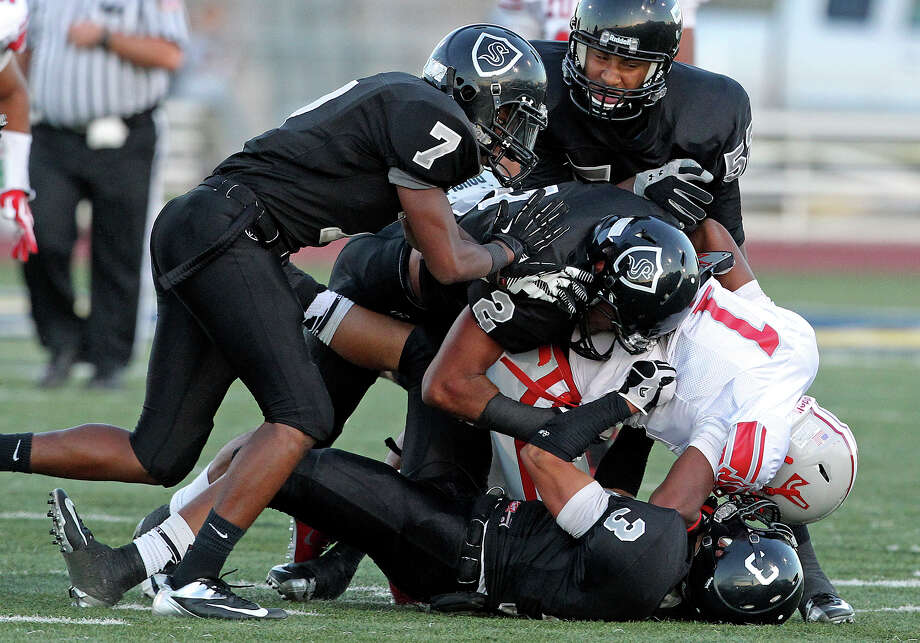 Knight defenders shut down Rashawn Morrison in the first series of plays as Steele hosts Judson at Lehnhoff Stadium on September 7, 2012. Photo: Tom Reel, Express-News / ©2012 San Antono Express-News