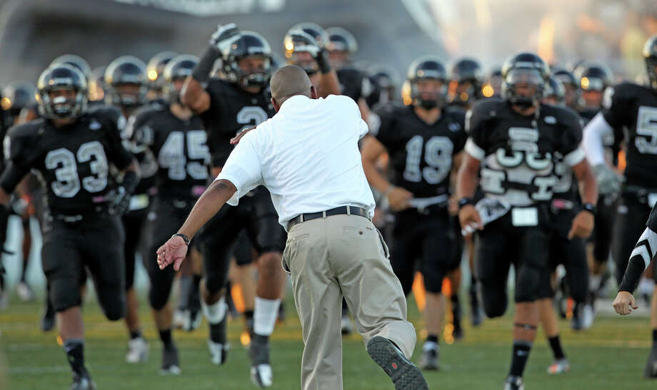 Coach Michael Jinks cheers his Knights onto the field as Steele hosts Judson at Lehnhoff Stadium on September 7, 2012. Photo: Tom Reel, Express-News / ©2012 San Antono Express-News