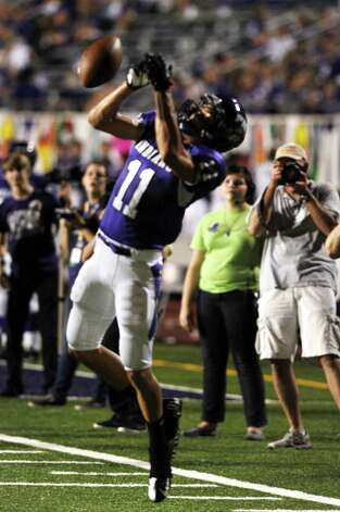 PNG wide receiver Logan Chipman just can't hang on to the ball during the game between PN-G Indians and WO-S Mustangs at PN-G High School on Friday, September 7, 2012. Photo taken: Randy Edwards/The Enterprise Photo: Randy Edwards