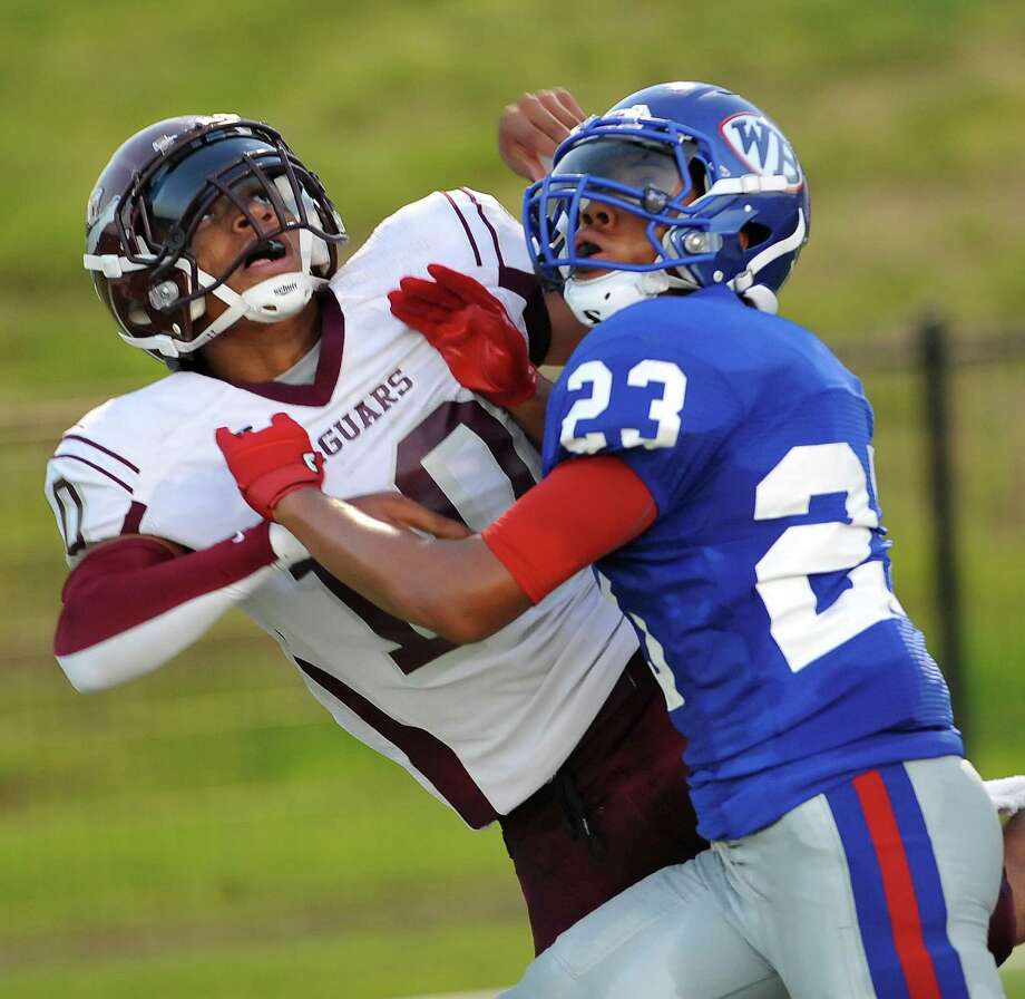 """Central #10, Garrison Mitchell, left, keeps his eyes on a touchdown pass as West Brook #23, Michael Mckee, tries to intercept it. The Central Medical Magnet High School football team played West Brook High School Friday night in the second Beaumont Bowl match up at the Carrol A. """"Butch Thomas Educational Support Center.  Both teams entered the Friday September 7 matchup with o-1 records.  At the half, West Brook was ahead 20-7. Dave Ryan/The Enterprise Photo: Dave Ryan"""