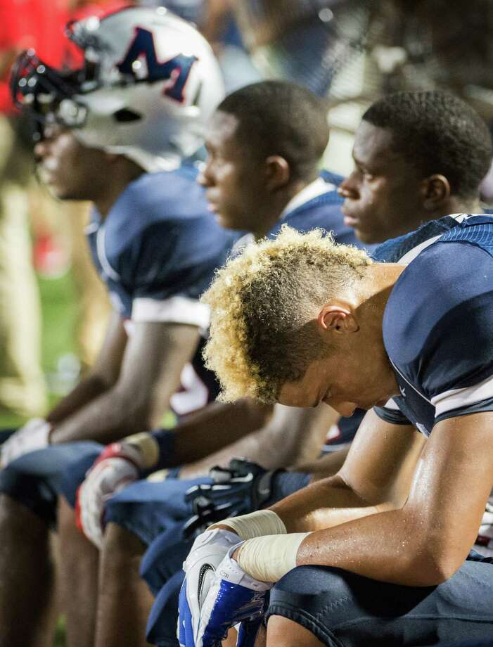 Manvel wide receiver Kyrion Parker hangs his head on the bench during the final moments of the second half of a high school football game on Friday, Sept. 7, 2012, in Alvin. North Shore won the game 56-28. Photo: Smiley N. Pool, Houston Chronicle / © 2012  Houston Chronicle