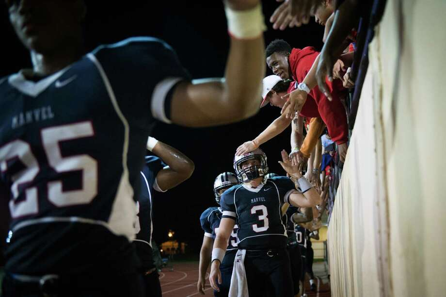 Manvel quarterback Shane McCarley (3) is consoled by fans after a high school football game on Friday, Sept. 7, 2012, in Alvin. North Shore won the game 56-28. Photo: Smiley N. Pool, Houston Chronicle / © 2012  Houston Chronicle