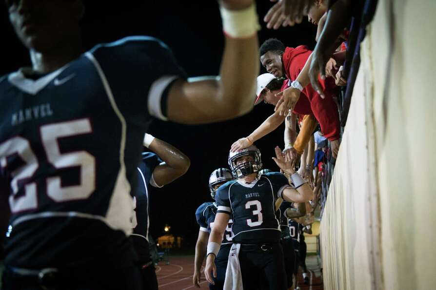 Manvel quarterback Shane McCarley (3) is consoled by fans after a high school football game on Frida