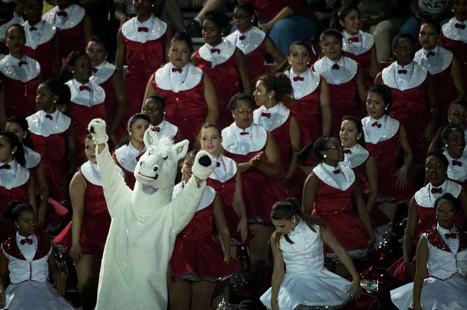 The North Shore Mustang mascot dances with the drill team during the second half of a high school football game against Manvel on Friday, Sept. 7, 2012, in Alvin. North Shore won the game 56-28. Photo: Smiley N. Pool, Houston Chronicle / © 2012  Houston Chronicle