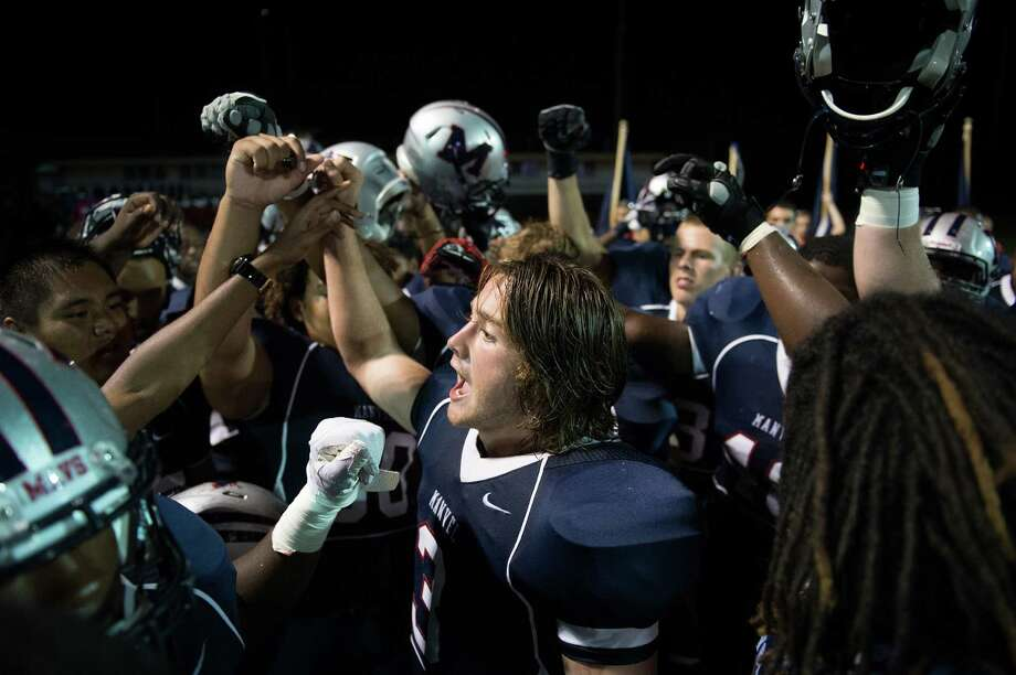 Manvel quarterback Shane McCarley huddles his team before the second half of a high school football game on Friday, Sept. 7, 2012, in Alvin. North Shore won the game 56-28. Photo: Smiley N. Pool, Houston Chronicle / © 2012  Houston Chronicle