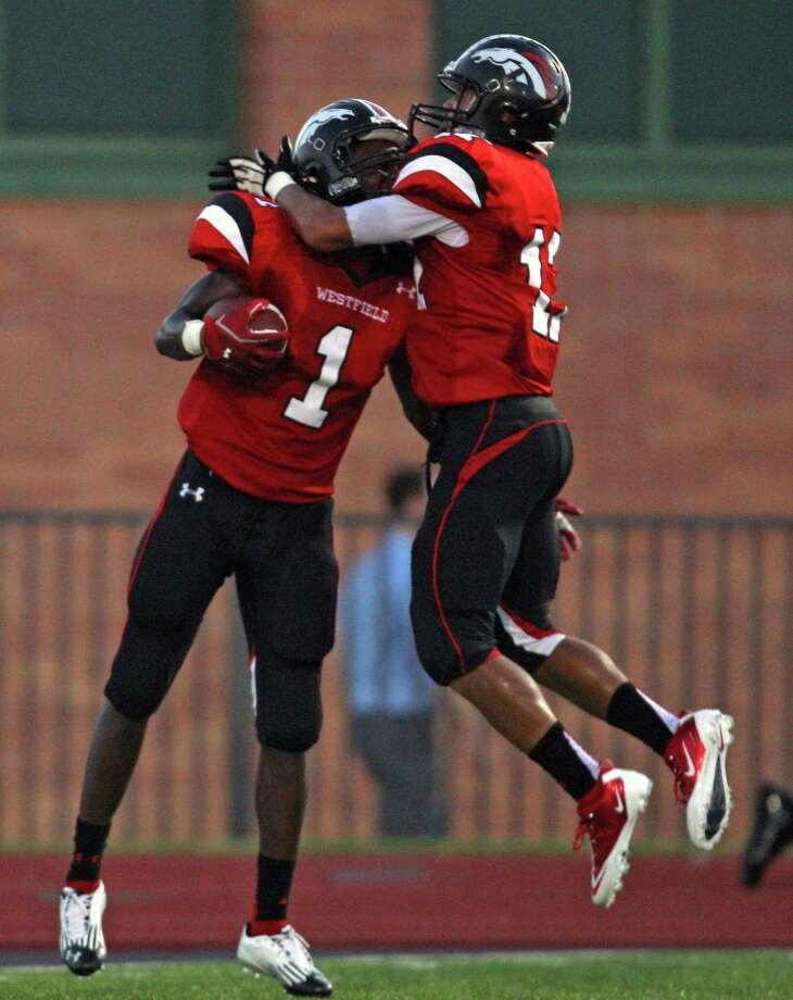 Westfield's Tevin Lewis (1) celebrates his 88-yard punt retuyen for a touchdown with Jason Reid during the first half of a high school football game against Memorial, Friday, September 7, 2012 at George Stadium in Spring, TX. Photo: Eric Christian Smith, For The Chronicle