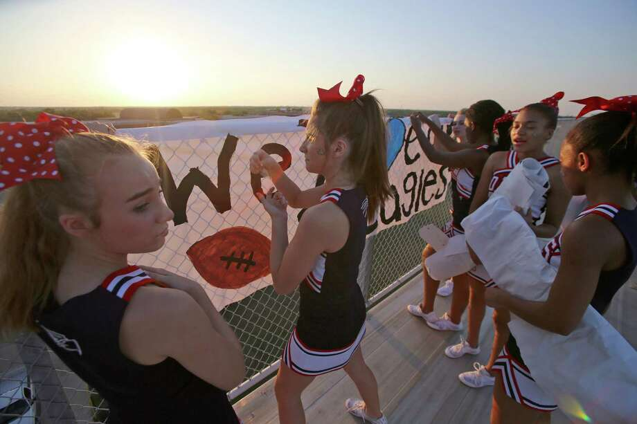 9/7/12: Dawson's cheerleaders put up cheer signs before Dawson played against Montgomery at the RIG in Pearland, Texas. Photo: Thomas B. Shea, For The Chronicle / © 2012 Thomas B. Shea
