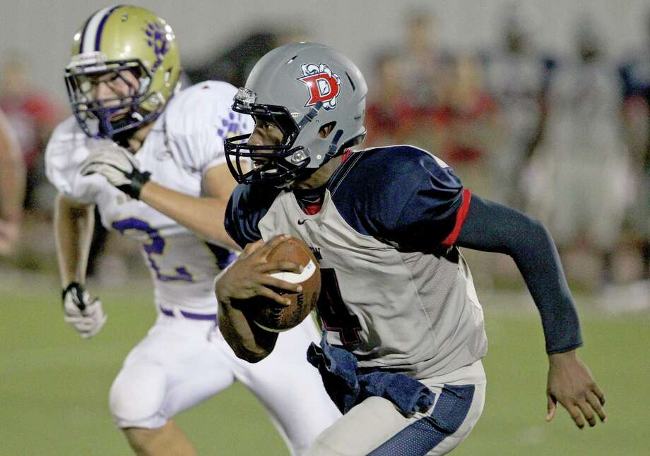 9/7/12: Dawson's Josh Sharp runs against Montgomery's Clint Ivy #21 at the RIG in Pearland, Texas. Photo: Thomas B. Shea, For The Chronicle / © 2012 Thomas B. Shea