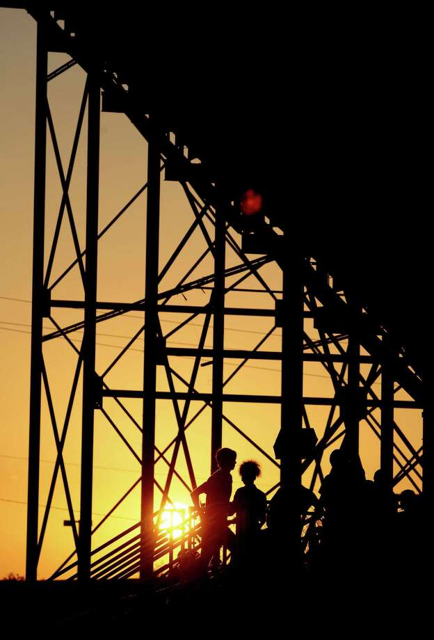9/7/12: The sun sets as fans attend the Dawson's vs. Montgomery's football game at the RIG in Pearland, Texas. Photo: Thomas B. Shea, For The Chronicle / © 2012 Thomas B. Shea
