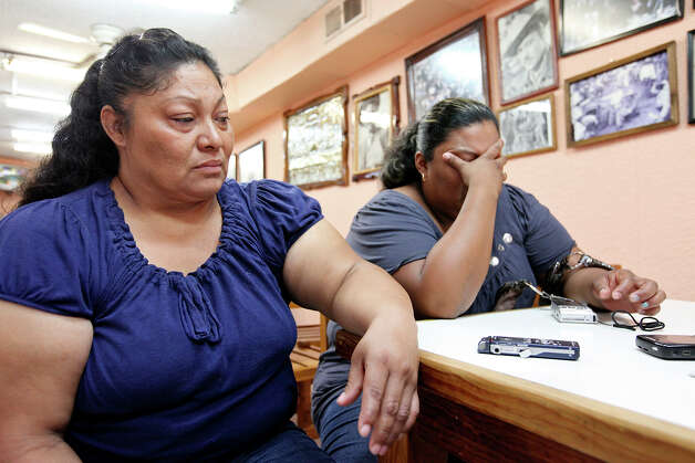 Alejandra Gallegos Flores (left) talks about her son-in-law, Guillermo Arévalo Pedroza, 36, who was allegedly shot and killed by a U.S. Border Patrol agent Monday Sept. 3, 2012 on the Rio Grande, as her daughter Pedroza's wife Nora Isabel Lam Gallegos, 26, cries Friday Sept. 7, 2012 in Nuevo Laredo, Tamalipas, Mexico. Photo: Edward A. Ornelas, San Antonio Express-News / © 2012 San Antonio Express-News