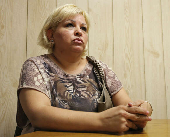 Veronica Martinez, 40, answers questions, Thursday Sept. 6, 2012 in Laredo, about the the shooting and death of Mexican citizen Guillermo Arévalo Pedroza, 36, allegedly by a U.S. Border Patrol agent Monday Sept. 3, 2012 in Nuevo Laredo, Tamalipas, Mexico on the Rio Grande. Photo: Edward A. Ornelas, San Antonio Express-News / © 2012 San Antonio Express-News