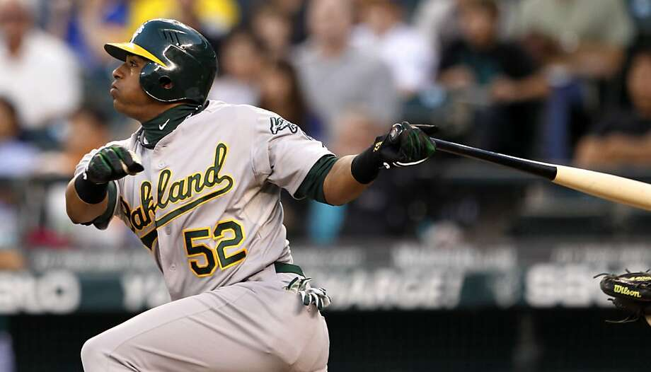 Oakland Athletics' Yoenis Cespedes singles in a run against the Seattle Mariners in the first inning of a baseball game Friday, Sept. 7, 2012, in Seattle. (AP Photo/Elaine Thompson) Photo: Elaine Thompson, Associated Press