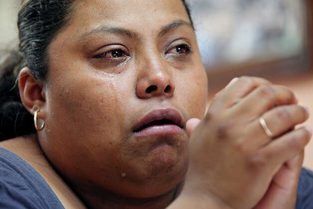 Nora Isabel Lam Gallegos, 26, cries, Friday Sept. 7, 2012 in Nuevo Laredo, Tamalipas, Mexico,  as she talks about her husband Guillermo Arévalo Pedroza, 36, who was allegedly shot and killed by a U.S. Border Patrol agent Monday Sept. 3, 2012 on the Rio Grande. Photo: Edward A. Ornelas, San Antonio Express-News / © 2012 San Antonio Express-News
