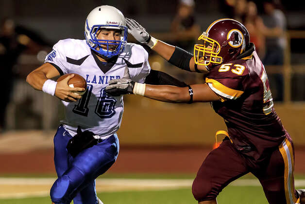 Harlandale's Nicholas Rodriguez (right) closes in on Lanier quarterback Nick Garcia for a sack during the third quarter of their game at Harlandale Memorial Stadium on Sept. 7, 2012.  Harlandale won the game 58-16.  MARVIN PFEIFFER/ mpfeiffer@express-news.net Photo: MARVIN PFEIFFER, Express-News / Express-News 2012