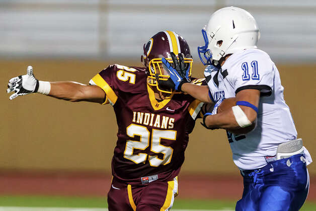 Lanier's Rodrigo Garcia (right) stiff-arms Harlandale's Fabian Trevino as he tries to avoid the tackle during their game at Harlandale Memorial Stadium on Sept. 7, 2012.  MARVIN PFEIFFER/ mpfeiffer@express-news.net Photo: MARVIN PFEIFFER, Express-News / Express-News 2012