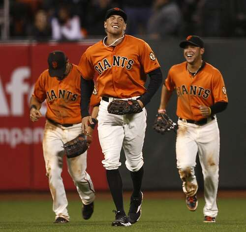 Giants Angel Pagan #16 (left), Hunter Pence #8 (middle), and Gregor Blanco #7 (right) celebrating after the game in San Francisco, Calif.,as they win 5-2 against the Dodgers on Friday, September 7, 2012. Photo: Liz Hafalia, The Chronicle
