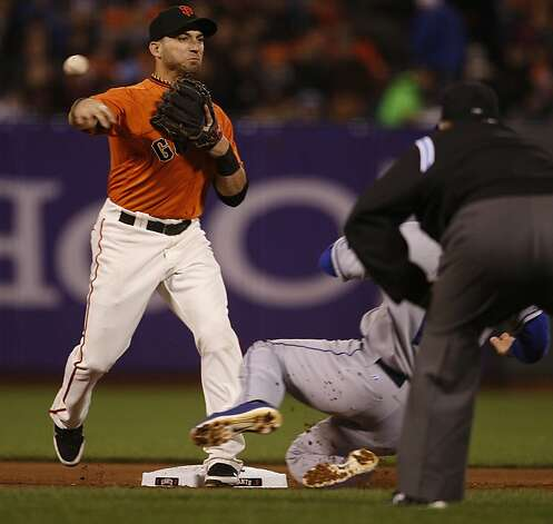 Giant #19 Marco Scutaro takes Dodger #14 Mark Ellis out at second base during the fifth inning in San Francisco, Calif., on Friday, September 7, 2012. Photo: Liz Hafalia, The Chronicle