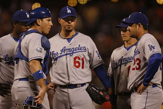 Dodgers gather at the pitcher's mound with Josh Beckett (#61) as bases are loaded during the seventh inning in San Francisco, Calif., on Friday, September 7, 2012. Photo: Liz Hafalia, The Chronicle