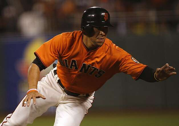 Giant Gregor Blanco dives for first base during the seventh inning at AT&T park in San Francisco, Calif., s they play against the Dodgers on Friday, September 7, 2012. Photo: Liz Hafalia, The Chronicle