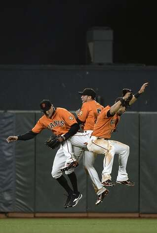 SAN FRANCISCO, CA - SEPTEMBER 07:  (L-R) Hunter Pence #8, Gregor Blanco #7 and Angel Pagan #16 of the San Francisco Giants celebrates defeating the Los Angeles Dodgers 5-2 at AT&T Park on September 7, 2012 in San Francisco, California.  (Photo by Thearon W. Henderson/Getty Images) Photo: Thearon W. Henderson, Getty Images