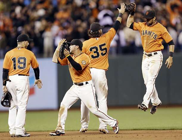 From left, San Francisco Giants' Marco Scutaro (19), Gregor Blanco, Brandon Crawford and Angel Pagan celebrate a 5-2 win over the Los Angeles Dodgers during a baseball game on, Friday, Sept. 7, 2012 in San Francisco. (AP Photo/Marcio Jose Sanchez) Photo: Marcio Jose Sanchez, Associated Press