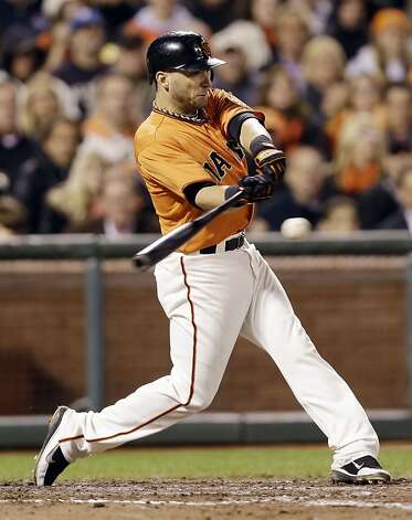 San Francisco Giants' Marco Scutaro drives in two runs with a bases-loaded single against the Los Angeles Dodgers during the seventh inning of a baseball game on, Friday, Sept. 7, 2012 in San Francisco. (AP Photo/Marcio Jose Sanchez) Photo: Marcio Jose Sanchez, Associated Press