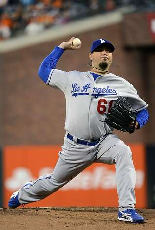 SAN FRANCISCO, CA - SEPTEMBER 07:  Josh Beckett #61 of the Los Angeles Dodgers pitches against the San Francisco Giants at AT&T Park on September 7, 2012 in San Francisco, California.  (Photo by Thearon W. Henderson/Getty Images) Photo: Thearon W. Henderson, Getty Images