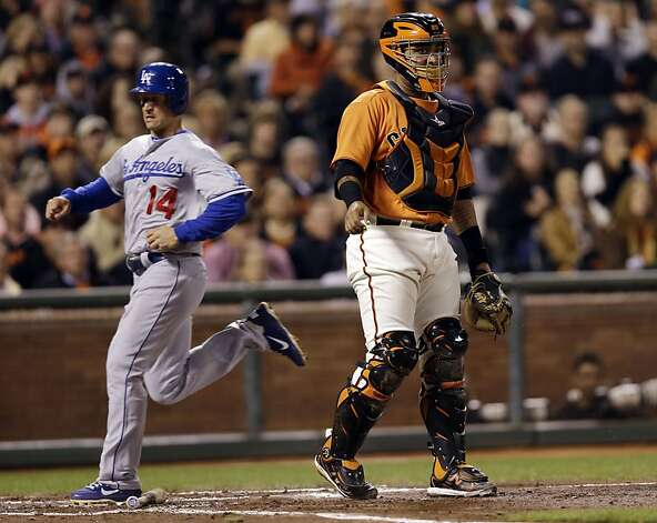 Los Angeles Dodgers' Mark Ellis (14) scores from third base past San Francisco Giants catcher Hector Sanchez during the third inning of a baseball game Friday, Sept. 7, 2012, in San Francisco. (AP Photo/Marcio Jose Sanchez) Photo: Marcio Jose Sanchez, Associated Press