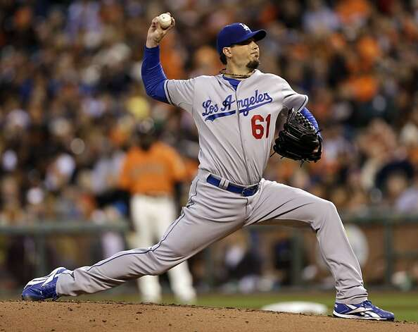 Los Angeles Dodgers starting pitcher Josh Beckett throws to the San Francisco Giants during the first inning of a baseball game Friday, Sept. 7, 2012, in San Francisco. (AP Photo/Marcio Jose Sanchez) Photo: Marcio Jose Sanchez, Associated Press