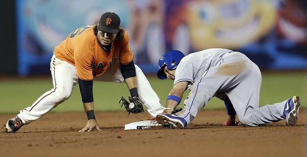 Los Angeles Dodgers' Shane Victorino, right, steals second base past the tag attempt by San Francisco Giants shortstop Brandon Crawford during the fifth inning of a baseball game Friday, Sept. 7, 2012, in San Francisco. (AP Photo/Marcio Jose Sanchez) Photo: Marcio Jose Sanchez, Associated Press