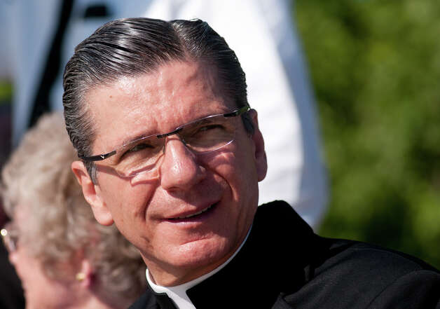 "Archbishop Gustavo García-Siller smiles  prior to  a ceremony commemorating the 25th anniversary of Pope John Paul II's visit to San Antonio. The ""Blessed John Paul II Monument"" will now be near the corner of Potranco and Dugas, adjacent to Stevens High School. Friday, Sept. 7, 2012. Photo: Robin Jerstad, For The Express-News"