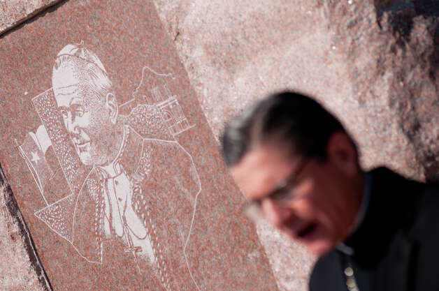 "The ""Blessed John Paul II Monument"" stands behind Archbishop Gustavo García-Siller during a ceremony to commemorate the Pontiff's visit to San Antonio 25 years ago. The monument is adjacent to Stevens High School. Friday, Sept. 7, 2012. Photo: Robin Jerstad, For The Express-News"