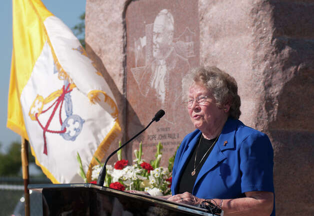 "Sister Charlene Wedelich CDP speaks during a ceremony commemorating the 25th anniversary of the Pope John Paul II's visit to San Antonio. The ""Blessed John Paul II Monument"" will now be near the corner of Potranco and Dugas, adjacent to Stevens High School. The flag at left is the Papal flag. Friday, Sept. 7, 2012. Photo: Robin Jerstad, For The Express-News"