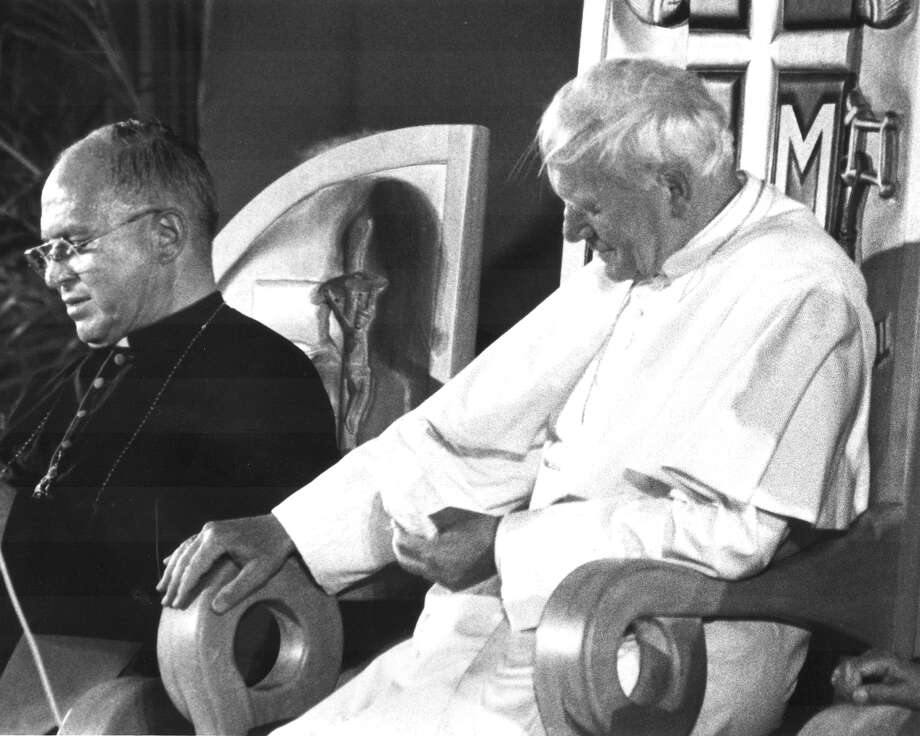 Archbishop Patrick Flores sits with Pope John Paul II during the pontiff's visit to San Antonio on Sept. 13, 1987. Photo: San Antonio Express-News File Photo / SAN ANTONIO EXPRESS-NEWS