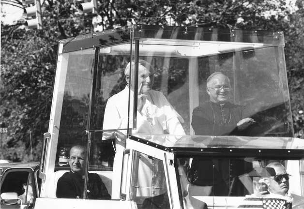 Archbishop Patrick Flores rides with Pope John Paul II in the Pope Mobile during the pontiff's visit to San Antonio Sept. 13, 1987. Photo: San Antonio Express-News File Photo / SAN ANTONIO EXPRESS-NEWS