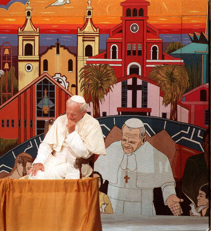 Pope John Paul II prays in front of a crowd at Guadalupe Plaza Sunday, Sept. 13, 1987 during his visit to San Antonio. Photo: San Antonio Express-News File Photo / SAN ANTONIO EXPRESS-NEWS