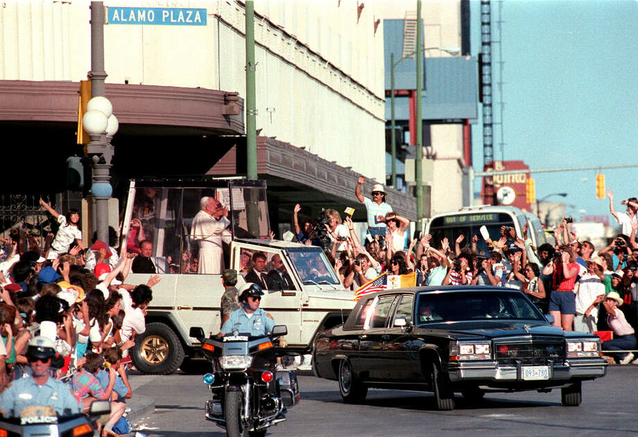 Pope John Paul II waves to a crowd at the corner of Alamo and Commerce streets on Sunday, Sept. 13, 1987 during his visit San Antonio. Photo: San Antonio Express-News File Photo / SAN ANTONIO EXPRESS-NEWS