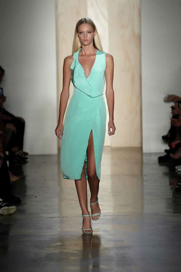 In this photo provided by Cushnie et Ochs, the Cushnie et Ochs  Spring 2013 collection is modeled. Photo: Cushnie Et Ochs,Thomas Kletecka