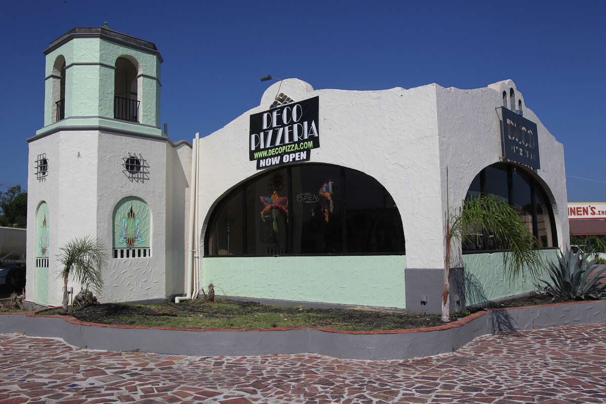 This is the Deco Pizzeria at 1815 Fredericksburg Road. The pizzeria's owner, Jacob Valenzuela, says the building awaits City Council action on historic landmark designation. A former 1938 gas station, the bulding resembles a mini Spanish mission and has an enclosed dining area where gas pumps once stood.