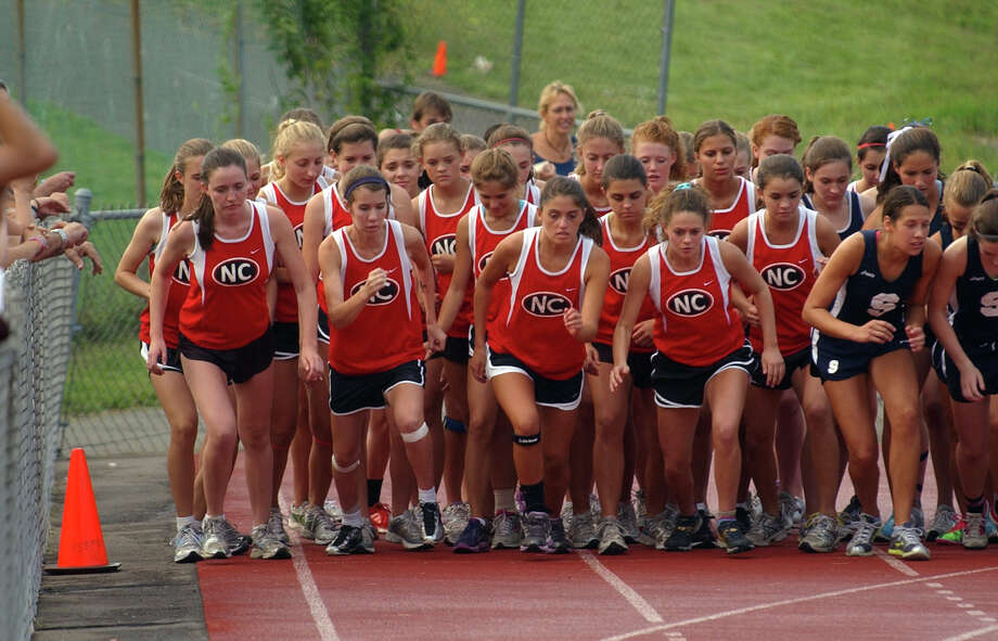New Canaan girls take off from the starting line during girls cross country action at Staples High in Westport, Conn. on Tuesday September 14, 2011. Photo: Christian Abraham / Connecticut Post