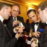 Chip Zecher, Mark Wagoner, Alan Malouf and Matthew Kimball (left to right) compare cufflinks during intermission at the San Francisco Opera Opening Night Gala at War Memorial Opera House in San Francisco, Calf., on Friday, September 7, 2012.